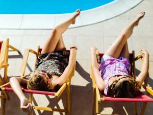 Beautiful women relaxing and sunbathing in resort
